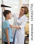 Doctor Measures Growth Kid Boy...