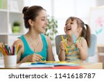 mom helping her child daughter... | Shutterstock . vector #1141618787