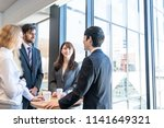 group of businessperson holding ... | Shutterstock . vector #1141649321