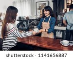 barista served hot coffee cup... | Shutterstock . vector #1141656887