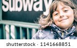 smiling face of young girl in... | Shutterstock . vector #1141668851