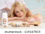 attractive blonde relaxing in... | Shutterstock . vector #114167815