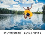 A Little Girl Jumping Off The...