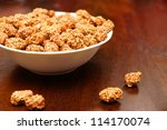 peanuts covered with honey and... | Shutterstock . vector #114170074