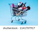set of makeup cosmetics with... | Shutterstock . vector #1141707917