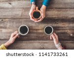 people hands holding a cup of...   Shutterstock . vector #1141733261