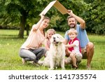 family with cardboard roof as... | Shutterstock . vector #1141735574