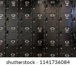 rows of modern black lockers in ... | Shutterstock . vector #1141736084