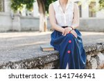 young woman wearing white...   Shutterstock . vector #1141746941