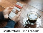 businessman holding smartphone... | Shutterstock . vector #1141765304