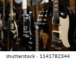 electric guitars hanging on... | Shutterstock . vector #1141782344