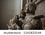 kneeling statues of praying... | Shutterstock . vector #1141823144