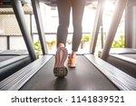 image of female foot running on ... | Shutterstock . vector #1141839521