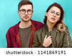 fashion couple standing posing... | Shutterstock . vector #1141869191
