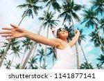 happy smiling woman in santa... | Shutterstock . vector #1141877141