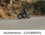 man in black leather jacket... | Shutterstock . vector #1141886951