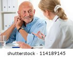 doctor talking to her male...   Shutterstock . vector #114189145