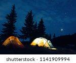 camp in summer mountains  tent...   Shutterstock . vector #1141909994