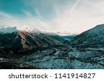 a road going through the snowy... | Shutterstock . vector #1141914827