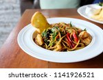 spaghetti with spicy mixed... | Shutterstock . vector #1141926521