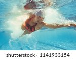 underwater shot of woman... | Shutterstock . vector #1141933154