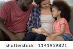 young parents find approach to... | Shutterstock . vector #1141959821