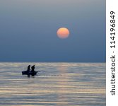Silhouettes Of Two Fishermen...