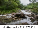 small waterfall with crystal... | Shutterstock . vector #1141971551