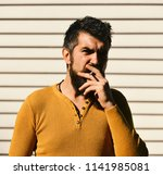guy with beard smokes outside.... | Shutterstock . vector #1141985081