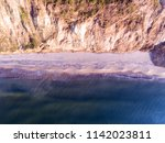 narrow beach line  waves and... | Shutterstock . vector #1142023811