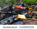 toasting bread and sausage over ... | Shutterstock . vector #1142042234