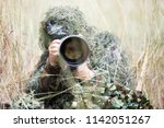 photographer in ghillie suit... | Shutterstock . vector #1142051267
