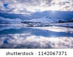 beautiful winter view with blue ... | Shutterstock . vector #1142067371