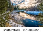 winter forest river reflection... | Shutterstock . vector #1142088854