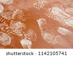 footprint on dusty concrete or... | Shutterstock . vector #1142105741