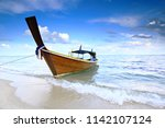fishing wooden boats resting at ... | Shutterstock . vector #1142107124