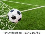 soccer football in goal net...   Shutterstock . vector #114210751