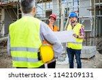 building construction crew | Shutterstock . vector #1142109131