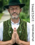 portrait of bavarian man... | Shutterstock . vector #1142139941