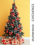 beautiful christmas tree with...   Shutterstock . vector #1142165621