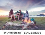 group of travelers camping and... | Shutterstock . vector #1142188391