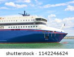 large ferry enters in port | Shutterstock . vector #1142246624