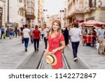 beautiful woman in red dress... | Shutterstock . vector #1142272847
