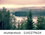 panoramic view of mountain lake.... | Shutterstock . vector #1142279624