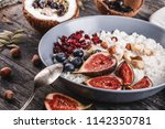 rice coconut porridge with figs ... | Shutterstock . vector #1142350781