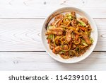 stir fried yakisoba noodle with ... | Shutterstock . vector #1142391011