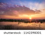 sunset reflect on water at lake ...   Shutterstock . vector #1142398301