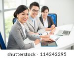 three young business colleagues ... | Shutterstock . vector #114243295