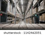 empty wood shelf on storage... | Shutterstock . vector #1142462051