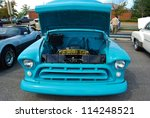 FREDERICK, MD- SEPTEMBER 16: Blue Vintage Ford Truck Hood at a Car Show on Sept. 16, 2012 in Frederick , MD USA. Alzheimer's Association Benefit Car Show at Motor Vehicle Administration in Maryland. - stock photo